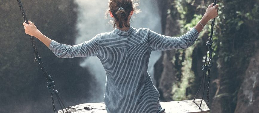 woman wearing grey long sleeved top photography